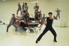 """""""Go, greased lightning!"""" John Travolta and the guys knew this just meant their car was  superfast."""