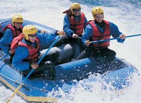 Four adults whitewater rafting. See more extreme sports pictures.