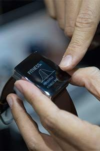 A Wellograph watch and activity tracker is displayed during a CES conference.  It's the only watch that can read heart rate variability which helps determine your stress level.