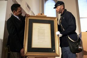 Civil War Image Gallery African American Civil War Museum founder and Executive Director Dr. Frank Smith Jr. (left) and Kevin Douglass-Green, great-great-grandson of Fredrick Douglass, position an original copy of the Emancipation Proclamation. See more pictures of the Civil War.