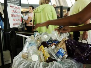 A trash container overflows with water bottles and other liquid items near the security checkpoint at Dulles Airport on August 10, 2006, in Chantilly, Va.