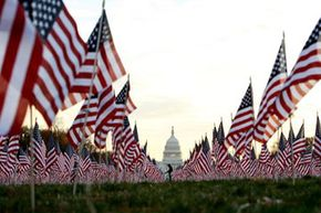 """American flags fly at the National Mall in Washington, D.C. in silent protest against the """"Don't Ask Don't Tell"""" policy prohibiting openly gay soldiers in the U.S. military. The protest was organized in 2007 by several gay rights lobbying groups."""