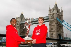 2010 London Marathon winners Tsegaye Kebede and Liliya Shobukhova pose with the trophy.