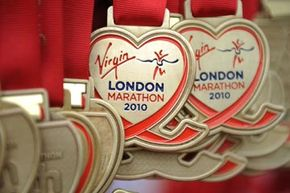 Runners medals wait to be handed out during the 2010 Virgin London Marathon.