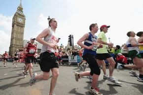 Participants run through Parliament Square in Westminster during the 2010 Virgin London Marathon.