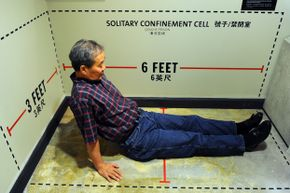 Harry Wu sits in an exhibit showing the exact dimensions of his solitary confinement cell where he spent 11 days at a labor prison camp. The exhibit was on display at the Laogai Museum on June 20, 2011, in Washington, D.C. Wu founded the U.S. museum, which is dedicated to exhibits about the forced labor prison camps and human rights abuses in China.