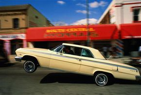 """Image Gallery: Custom Cars """"Lowrider drives a little slower."""" This 1962 Chevrolet Impala can hop and dance with the best of them, though. See more pictures of custom cars."""
