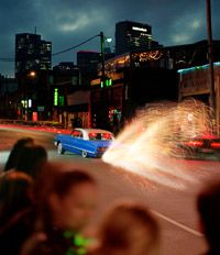 A lowrider in Dallas bounces down the street.