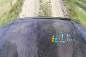 With the invisible hood, the driver has a much clearer view of where the wheels are, which makes climbing a steep incline or nosing along a thin trail much easier.