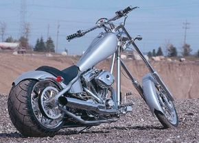 Arched chrome bars hold the strutless rear fender and turn signals, the latter required of factory bikes in many states.