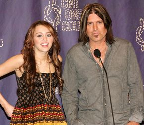 Publicists arrrange interviews for celebrities, including press conferences like this one featuring MIley and Billy Ray Cyrus.