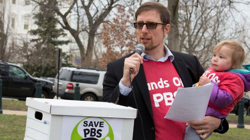Ben Winkler speaks to the crowd who came show their support for PBS, urging Congress not to defund CPB, near the Capitol on March 21, 2017, in Washington, D.C.  Tasos Katopodis/Getty Images for MoveOn.org