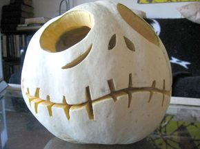 This Jack the Pumpkin King jack-o'-lantern uses a white pumpkin.