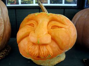 A three-dimensional face carved into a pumpkin at the North Carolina State Fair.