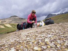 A girl makes lunch on a hike to Helen Lake in Alberta, Canada.