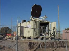 A prototype of the U.S. military's pain beam looks like a satellite dish. Eventually, a smaller system could be mounted to Humvees, planes and ships.