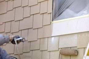 Practice using the sprayer on a piece of wood before trying it out on your house.