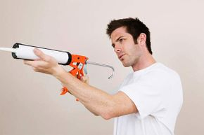 If you're using a manual caulk gun, look for one that has a smooth rod, which offers more control than its ratcheted counterpart.