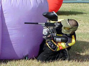 A player at the Mardi Gras Open 2000, a paintball tournament with hundreds of participants. See more paintball pictures.
