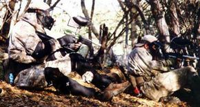 Players lie in wait for members of the rival team. Winning in paintball requires a combination of weapons skill and strategic planning.