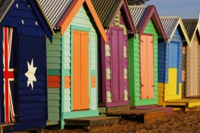 The paint jobs on those beach huts look professional. You can bet whoever painted them accounted for weather (and exposure to salt water).