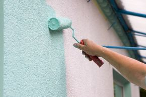 That minty ice cream color paint is going to adhere better to the stucco if you use the right roller (in this case, probably one with a 3/4 inch nap).