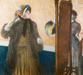 At the Milliner's by Hilaire-Germain-Edgar Degas is a pastel on pale gray woven paper, laid down on silk bolting (30 x 34 inches). This work can be seen at The Metropolitan Museum of Art, New York.