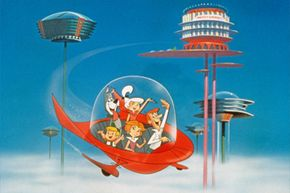 """The Jetson family waves as they fly past buildings in their spaceship in a still from the animated television series, """"The Jetsons,"""" circa 1962."""