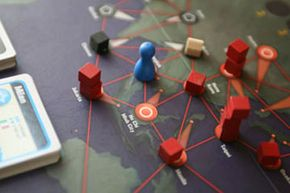 Disease cubes pile up in a game of Pandemic.