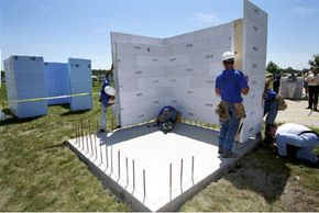 Workers in Sioux City, Iowa, construct a tornado shelterwith cement-filled foam walls.