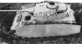 This Panzerkampfwagen IV Ausf H has been fitted with side plates surrounding the turret on three sides, as well as on either side of the hull.