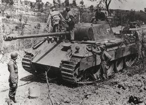 U.S. Army troops examine a Panzerkampfwagen V Panther that was knocked out of action in Italy.