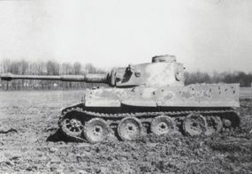 This view of the Panzerkampfwagen VI Tiger I shows the interleaved road wheels coated with mud. The wheels could easily jam if the mud froze.
