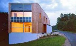 This passive house in Oed-Öhling, Austria is built of untreated larch.