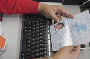 You'll need to have a photo taken for your fancy, new passport -- smile!