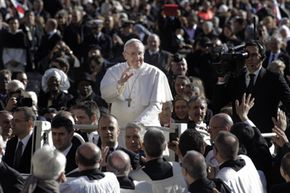 Pope Francis drives through the crowds during his inaugural mass in St. Peter's Square, Rome in 2013.