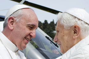 Pope Francis (left) embraces Pope Emeritus Benedict XVI as he arrives at the Castel Gandolfo summer residence on March 23, 2013. It is extremely rare for a pope to resign; the last time before Benedict was in 1415.
