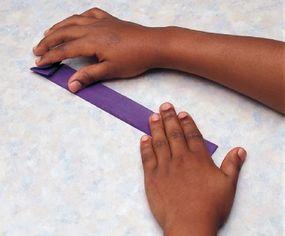 Fold the tissue paper into triangular pleats.