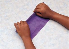 Fold the tissue paper in 1-inch accordion pleats.