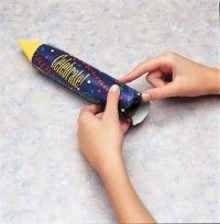 Push the extra paper inside of the tube.