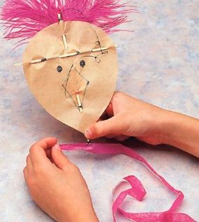Glue feathers and a tail to your paper kite.