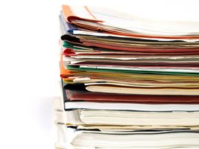 Paper can pile up quickly in a home office. There are many ways to lessen the paper piles. See more home office decor pictures.