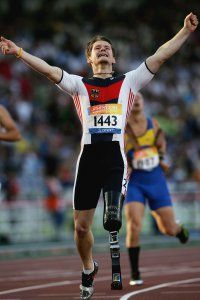 German Paralympic athlete Wojtek Czyz revels in his victory after he won gold at the 200-meter final of the 2004 Paralympic Games in Athens. See more Olympic pictures.
