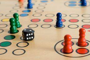Ludo, a U.K. version of Pachisi, is played on a slightly simplified board.