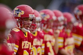 Players from Rancho Penasquitos, Calif. compete in the 1998 Pop Warner Pee Wee Super Bowl .