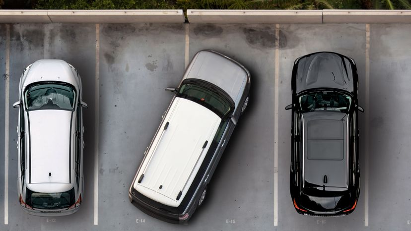 Parking in a way that inconveniences others violates social norms, but does it violate any laws? And what happens when you're parked on private property? Bernhard Lang/Slobo/Getty Images