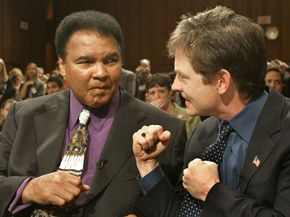 Boxer Muhammad Ali and actor Michael J. Fox pretend to spar before giving their testimony before the Senate Appropriations Subcommittee on Health and Human Services.