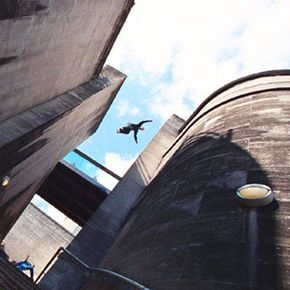 A person leaps across a gap.