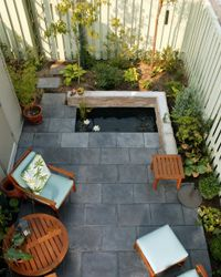 This patio is safe from prying eyes on all sides.