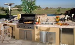 Outdoor kitchens are currently all the rage.